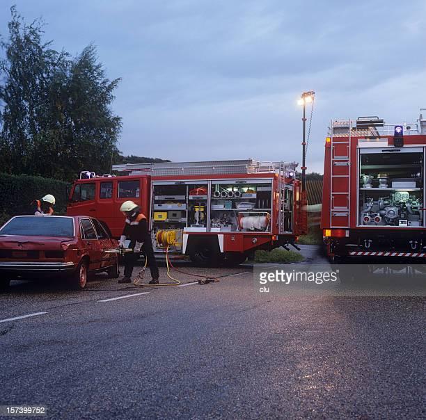 Fire brigade and damaged car