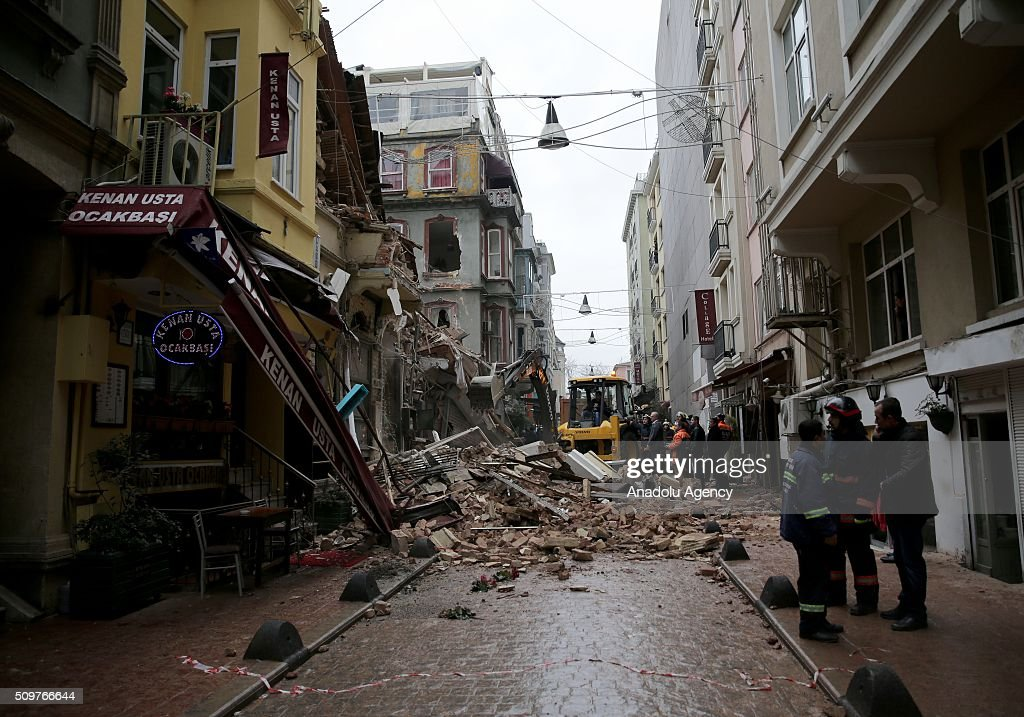 Fire Brigade and Municipality crews attend wreck removal work after 2 buildings collapsed with unknown reason at Zambak street of Tarlabasi neighborhood in Istanbul, Turkey on February 12, 2016.