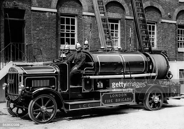 firefighters on a newly invented foam firefighting vehicle Photographer Eduard Schlochauer Published by 'Berliner Morgenpost' Vintage property of...