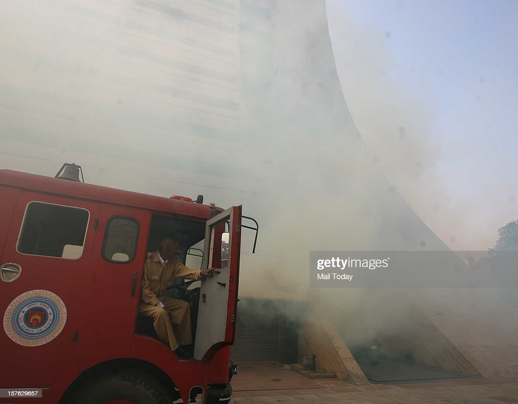 Fire Brigade personnel during a mock security drill as part of Delhi Emergency Management Exercise (DEMEX) at NDMC Building in New Delhi on Tuesday.