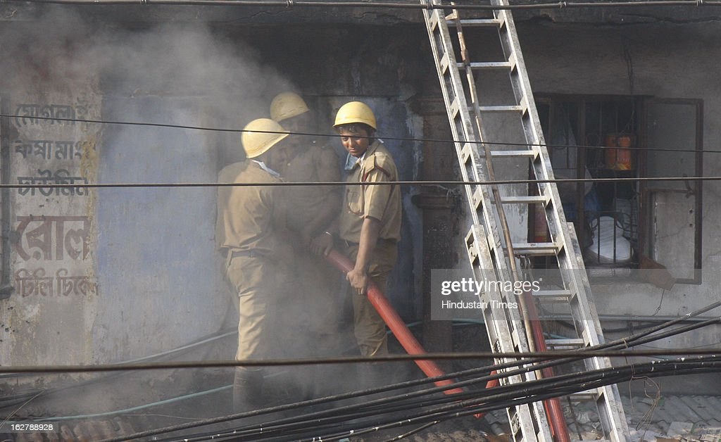 Fire brigade personnel work at incident place after fire engulfed a multi-storey market complex at Sealdah on February 27, 2013 in Kolkata, India. At least 19 people were killed in it. A dozen people were also critically injured in the fire that broke out at about 3 am at Sealdah in Central Kolkata, when many victims (Labours & shop keepers) were asleep. Even as 26 fire tenders battled the leaping flames and firemen scrambled to rescue people, many were feared trapped inside the market that houses plastic items, thermocol and paper godowns.