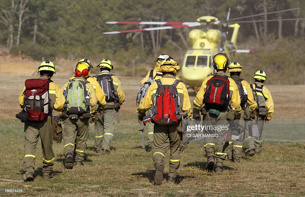 Fire Brigade reinforcement wait to be airlifted by helicopters to the wildfire in Tabuyo del Monte, near Leon on August 21, 2012. Spain's government Thursday denied crisis budget cuts had hit national resources for fighting this summer's spate of deadly wildfires. Numerous wildfires have broken out across Spain including a fire that has ravaged thousands of hectares on the Spanish island of La Gomera, part of the Canary Islands archipelago, in the sweltering heat in recent weeks