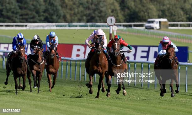 Fire Brigade ridden by Daniel Tudhope leads the field home to win the Betfred Racing 'Like Us On Facebook' Handicap Stakes during Betfred Rose of...