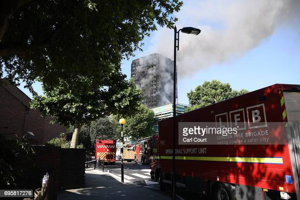 Fire brigade vehicles are parked near the 24 storey residential Grenfell Tower block in Latimer Road West London in the early hours of this morning...