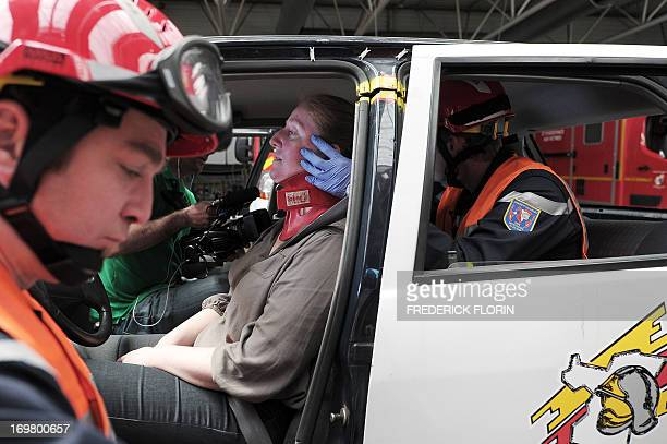 Fire brigades keep a person under hypnosis in a vehicule during an extrication exercise on May 28 2013 in Haguenau eastern France To relieve the...