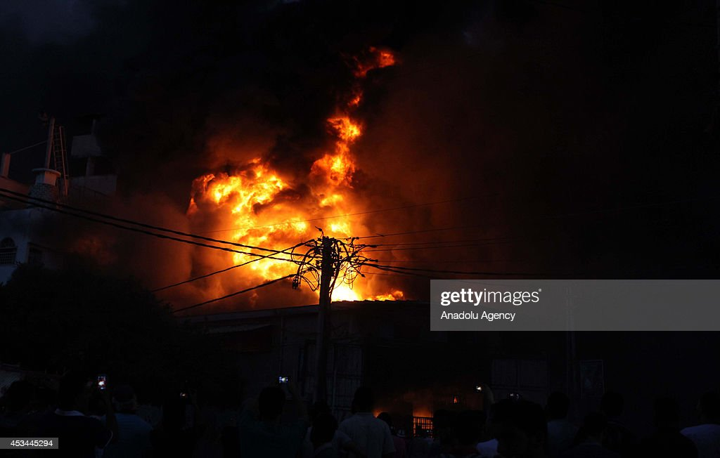 A fire broke out following the Israeli forces hit a factory, producing cleaning supplies, in Rimal neighborhood of Gaza City, Gaza on August 10, 2014.