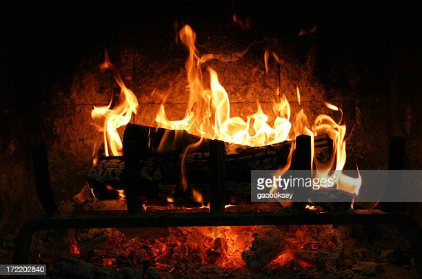 Fire burning in fireplace at night