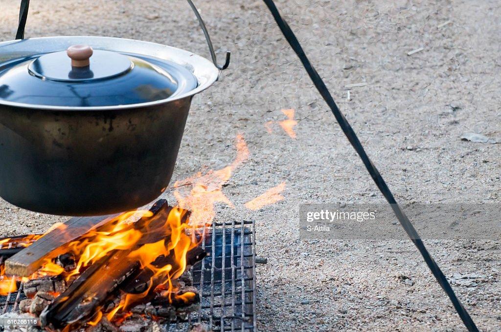 Fire burning under the cauldron : Stock Photo