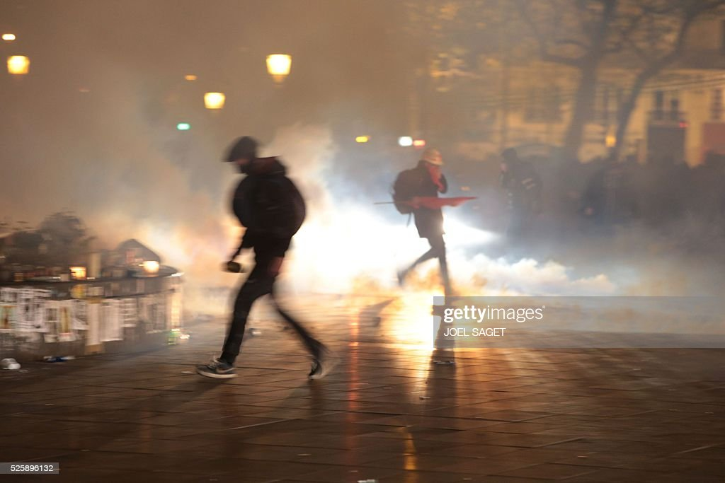 A fire burns at the Place de la Republique in Paris during a protest by the Nuit Debout, or 'Up All Night' movement who have been rallying against the French government's proposed labour reforms on April 29, 2016. Twenty-seven people were arrested and 24 detained during the overnight clashes in the French capital as the police dispersed the protesters who began their began movement on March 31 in opposition to the government's proposed labour reforms.