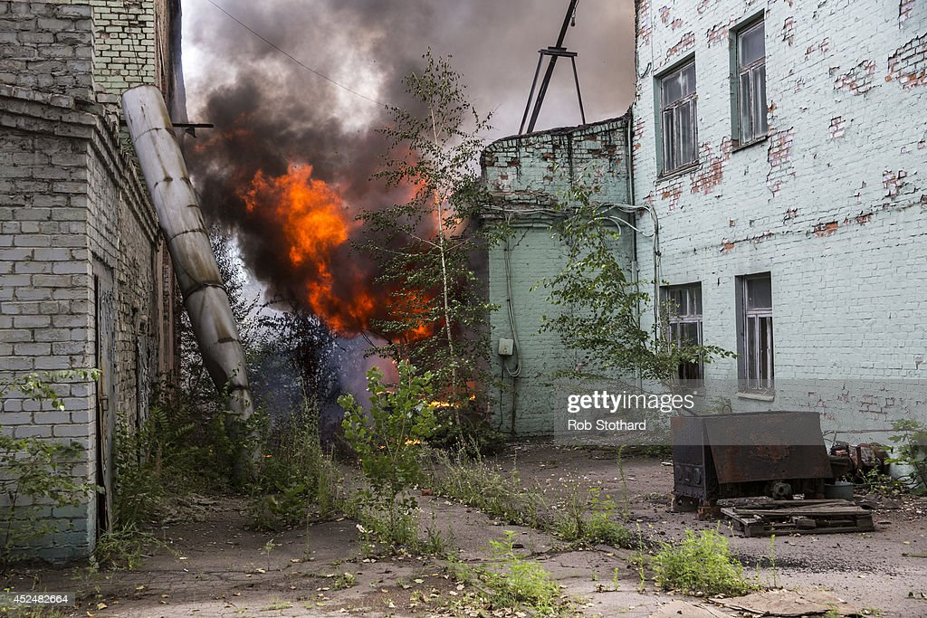 A fire burns in a factory complex hit by a rocket during fighting between pro-Russia rebels and Ukrainian government troops on July 21, 2014 in Donetsk, Ukraine. Local authorities warned residents in the area not to go outside or leave their homes whilst intense shelling set a market ablaze close to the station. The security situation is continuing to affect the investigation into the Malaysian Airlines flight MH17 crash and it is still unclear where or when the train containing the bodies of victims will be moved. Malaysian Airlines flight MH17 was travelling from Amsterdam to Kuala Lumpur when it crashed killing all 298 on board including 80 children. The aircraft was allegedly shot down by a missile and investigations continue over the perpetrators of the attack.