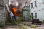 A fire burns in a factory complex hit by a rocket during fighting between proRussia rebels and Ukrainian government troops on July 21 2014 in Donetsk...