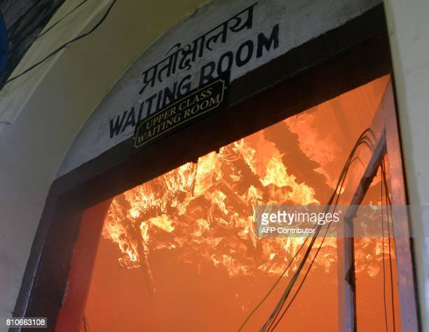Fire burns in a railway station during an indefinite strike called by separatist group Gorkha Janamukti Morcha in Darjeeling on July 8 2017 A...