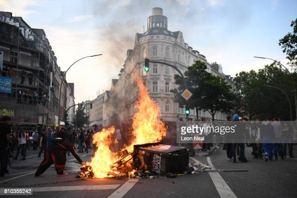 A fire burns in the middle of town during an antiG20 protest on July 7 2017 in Hamburg Germany Authorities are braced for largescale and disruptive...