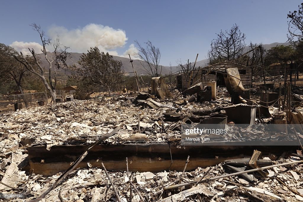 KERNVILLE, CA - JUNE 24, 2016- Fire burns in the mountains far behind a home on Sagebrush Road destroyed in the Erskine Fire that is close to a home where two people possibly died in the fire that consumed parts of the Squirrel Valley area near Lake Isabella as 100 structures have been lost in a fast-moving brush fire that broke out in a rural area of Kern County yesterday.