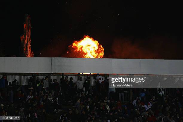 A fire burns just outside the perimter fence of the stadium during the IRB 2011 Rugby World Cup Pool A match between Tonga and Japan at Northland...