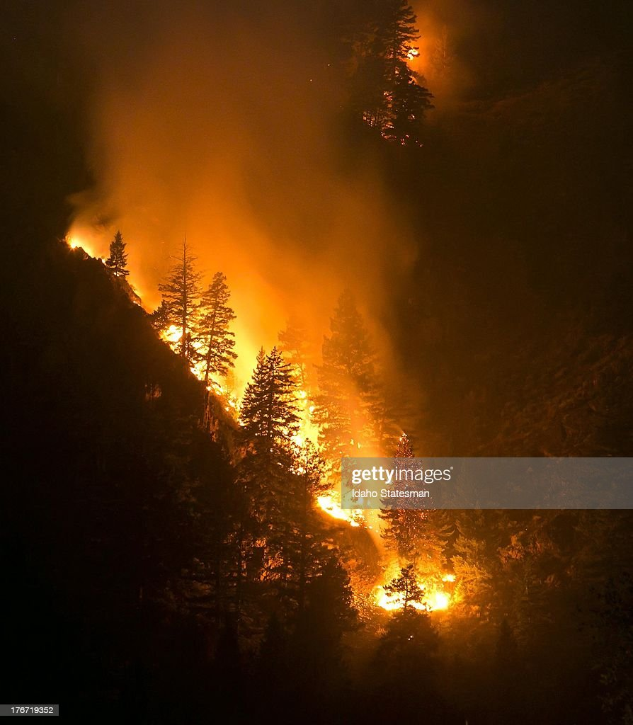 Fire creeps slowing down the western canyon wall above the Wood River in Hailey, Idaho, where firefighters continue to battle the Beaver Creek Fire on Saturday, August 17, 2013.