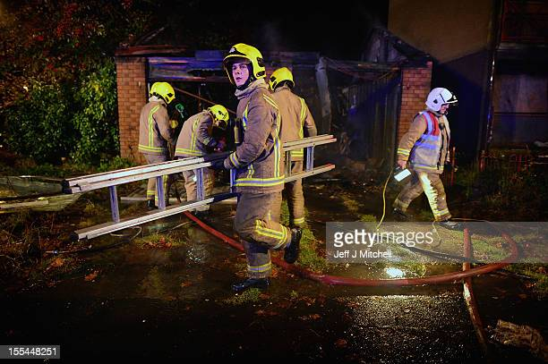 A fire crew attends an incident in Motherwell ahead of Bonfire Night on November 2 2012 in Motherwell Scotland Fire chiefs are asking members of the...