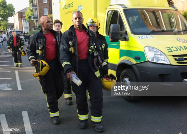 Fire crew near the 24 storey residential Grenfell Tower block in Latimer Road West London on June 14 2017 in London England The Mayor of London Sadiq...