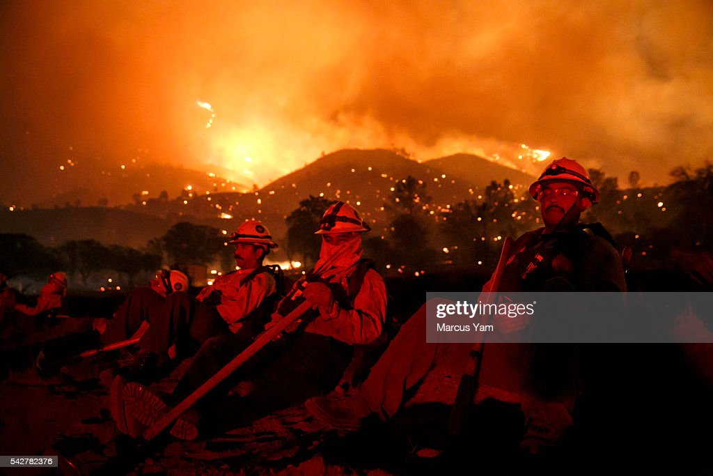 Fire crews take a break perform as winds calm down and the wildfire moving farther away from structures, in Lake Isabella, Calif., on June 24, 2016.