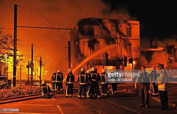 Fire crews try to extinguish a burning 140 year old furniture store in Croydon South London on August 8 2011 Now in it's third night of unrest London...