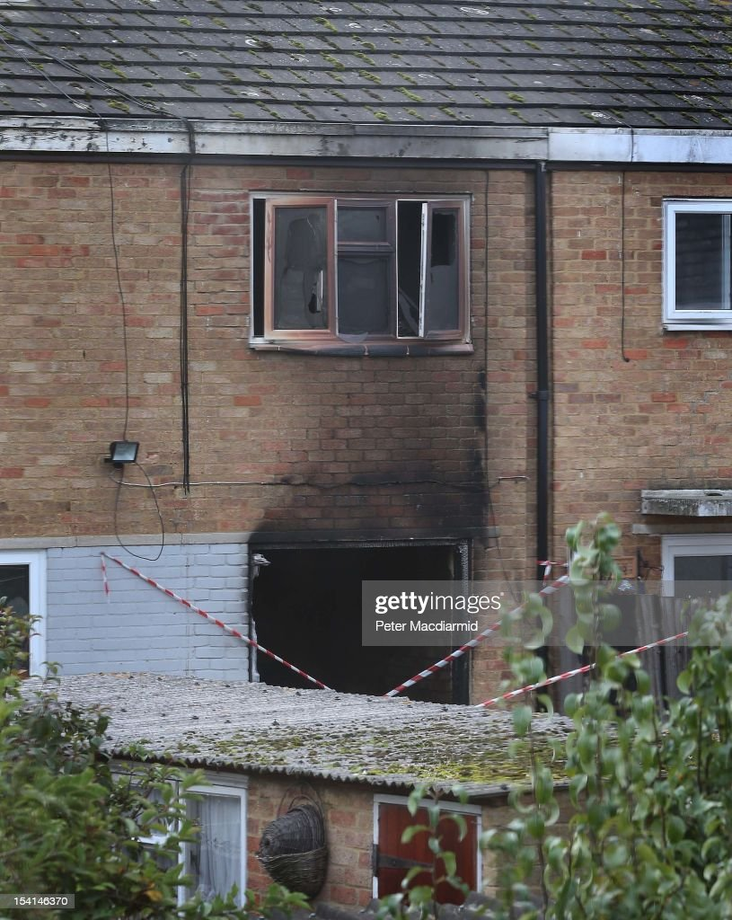 Fire damage shows at the back of a house where four people died in a fire on October 15, 2012 in Harlow, England. A woman and three children have died and another three are in hospital after a fire in a house on an estate near Harlow in Essex.
