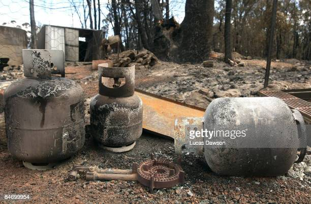 Fire damaged gas bottles are seen following the bushfires that swept through the region on February 9 2009 in Christmas Hills Australia Victoria...