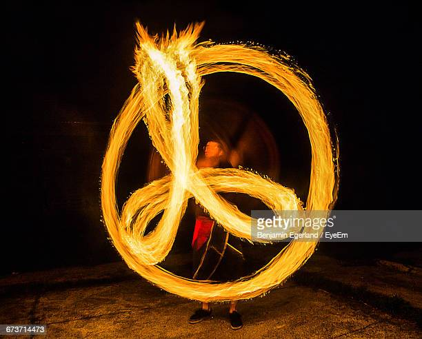 Fire Dancer Making Peace Sign During An Event