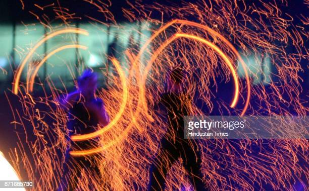 Fire dancers perform during the inaugural function of the 34th National Games at Birsa Munda Athletic stadium in Ranchi