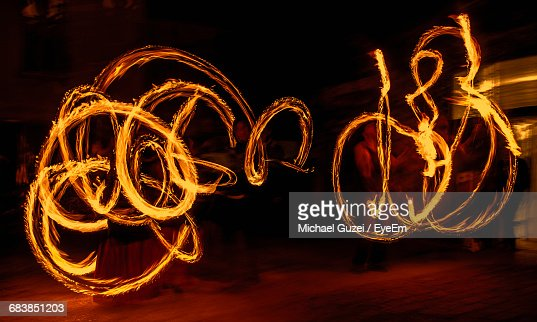 Fire Dancers Performing At Night