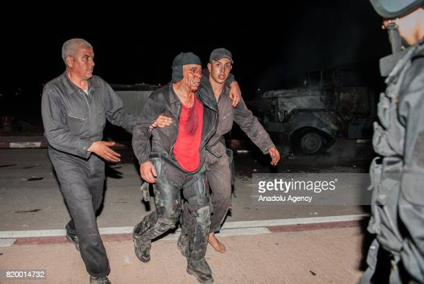 Fire department workers carry a wounded Moroccan in Al Hoceima Morocco on July 21 2017 Protesters continues to stage demonstrations for over 7 months...