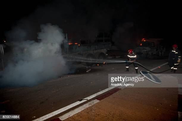 Fire department workers extinguish a vehicle belongs to Kingdom of Morocco's Gendarmerie after a demonstration continue over 7 months in Al Hoceima...