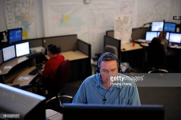 Fire dispatcher Trey Lewis is answering a call at Adams County 911 agency in Commerce City Colo on Thursday April 19 2012 Hyoung Chang The Denver Post
