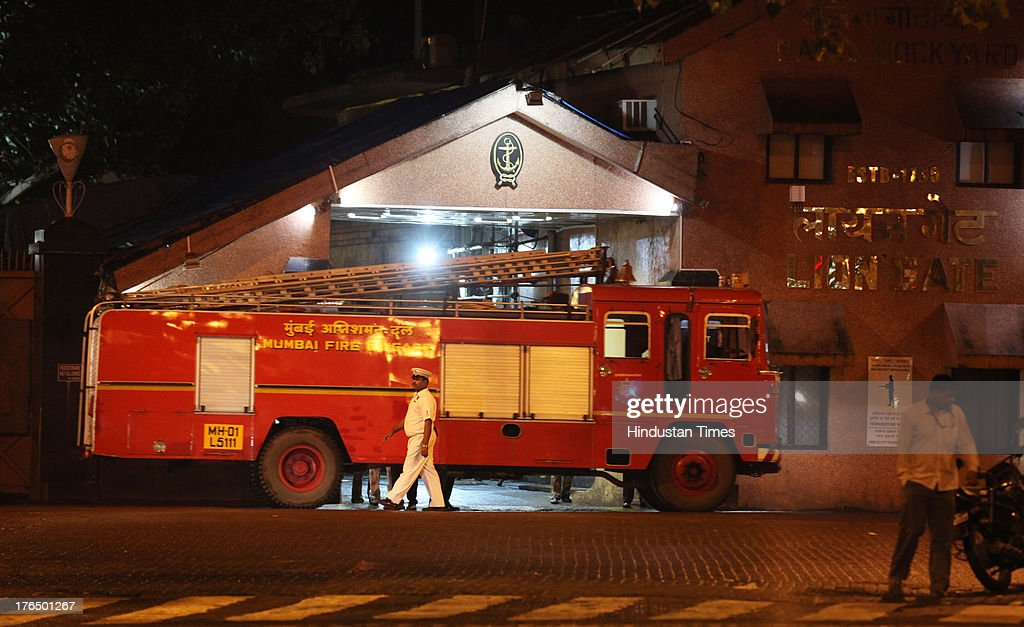 Fire engine coming out from Lion Gate after massive fire broke out in a submarine named INS Sindhurakshak in night at the Naval Dockyard on August 14, 2013 in Mumbai, India. The blast followed by a fire occurred shortly after midnight on the Russia-made submarines, INS Sindhurakshak which sank soon after getting gutted. The details of other casualty figures were not immediately available though some injured sailors have been rushed to naval hospital INHS Ashvini in Colaba.