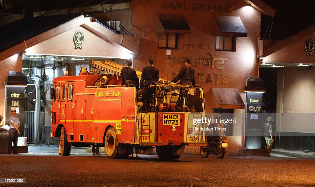 Fire engine going inside Lion Gate after massive fire broke out in a submarine named INS Sindhurakshak in night at the Naval Dockyard on August 14, 2013 in Mumbai, India. The blast followed by a fire occurred shortly after midnight on the Russia-made submarines, INS Sindhurakshak which sank soon after getting gutted. The details of other casualty figures were not immediately available though some injured sailors have been rushed to naval hospital INHS Ashvini in Colaba.