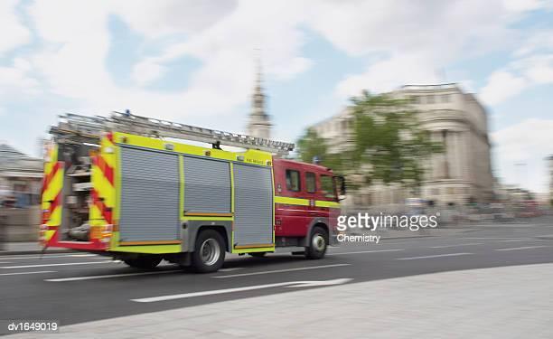 Fire Engine on a Road by Trafalgar Square, London, England, United Kingdom