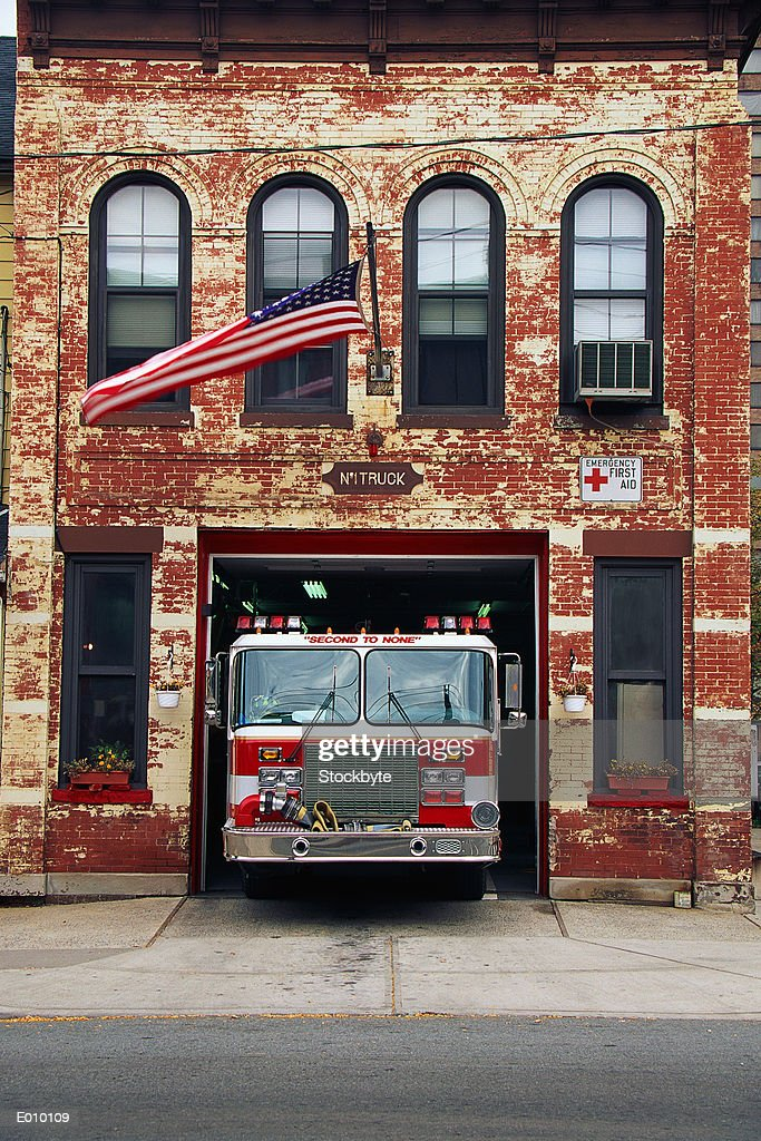 Fire engine parked in firehouse : Stock Photo