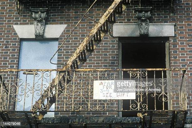 Fire escape and apartment for rent sign South Bronx New York