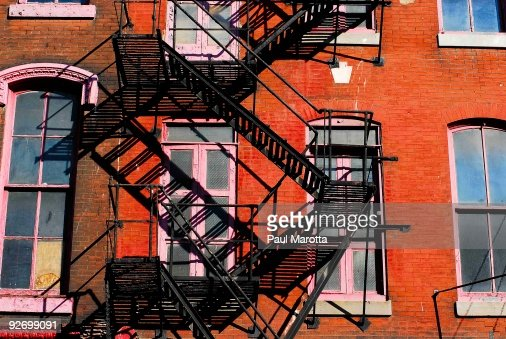 Fire Brick Red : Fire escape red brick building stock photo getty images