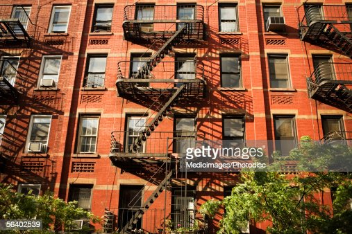 Fire escapes on an apartment building in Manhattan, New York City, NY, USA : Stock Photo
