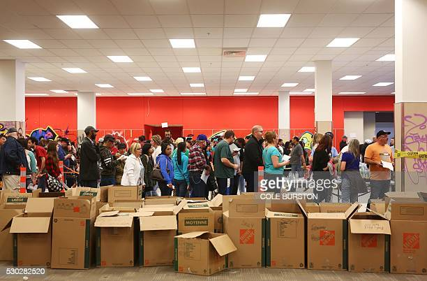Fire evacuees line up to receive donated clothing and necessities at an Emergency Relief Centre in Edmonton Alberta on May 10 2016 Oil companies...