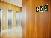 fire exit sign on a wall in an office