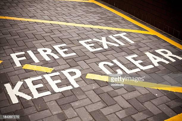 Fire Exit, Street Sign on asphalt