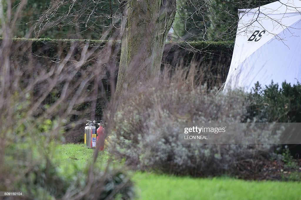 Fire extingishers are seen on the grass beside a tent errected over the scene where a man died after being discovered on fire in the park outside the wall of Kensington Palace in London on February 9, 2016. A man has died after being found on fire outside Kensington Palace in the early hours of February 9, police said. Officers were called to the London home of the Duke and Duchess of Cambridge after receiving reports a man was behaving suspiciously. On arrival a man was found on fire and despite efforts from officers and paramedics the man was pronouced dead at the scene. NEAL