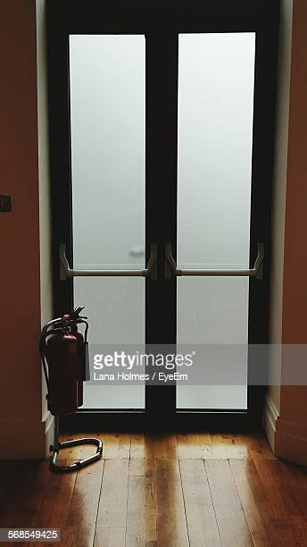 Fire Extinguisher By Door Indoors