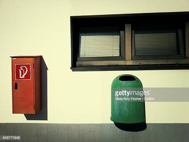Fire Extinguisher Cabinet And Garbage Can Stuck On Wall