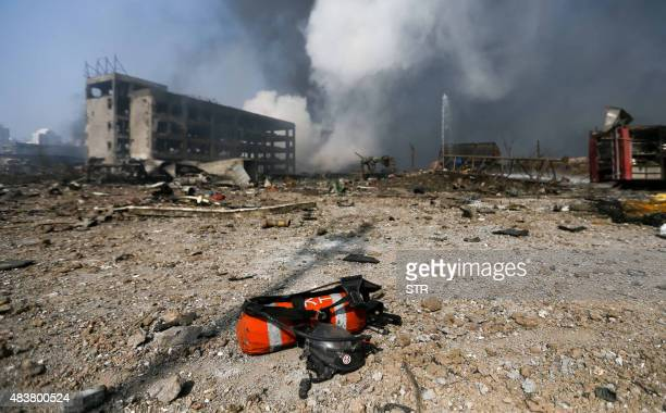 A fire extinguisher lies on the ground at the site of the massive explosions in Tianjin on August 13 2015 Enormous explosions in a major Chinese port...