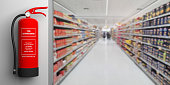 Fire safety, Red fire extinguisher on wall, blur supermarket corridor background, text label. 3d illustration