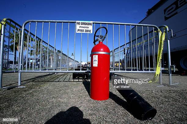A fire extinguisher sits by a no smoking sign during day one of the Coachella Valley Music Arts Festival 2009 held at the Empire Polo Club on April...