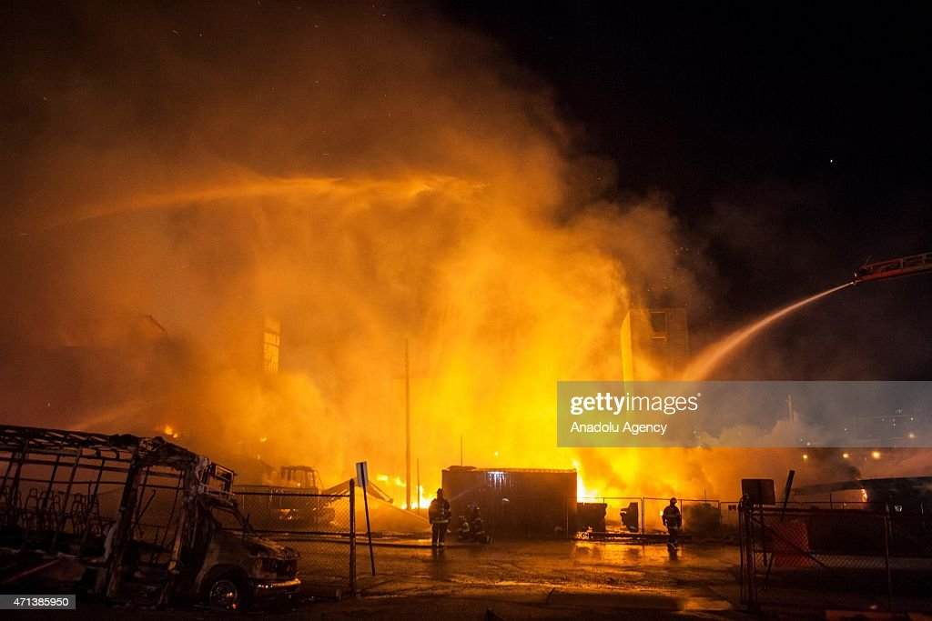 Fire Fighter attempt to put out a building that was set on fire during riots in Baltimore USA on April 27 2015 Protests following the death of...