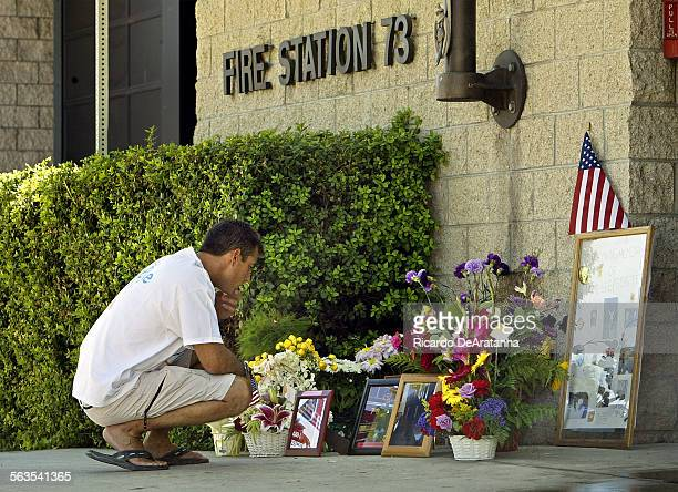 Fire fighter Dennis Garrison from Station 10 stops to pay his respect at the memorial in front of Station 73 on Reseda Blvd The station set up this...